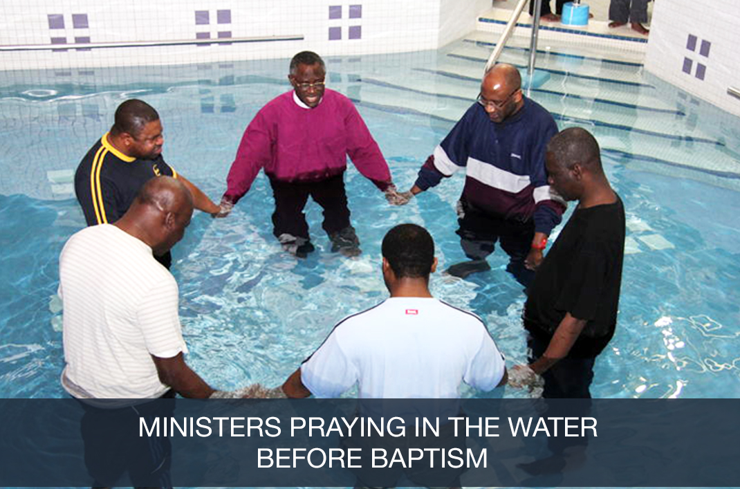 Ministers Praying Before Baptism